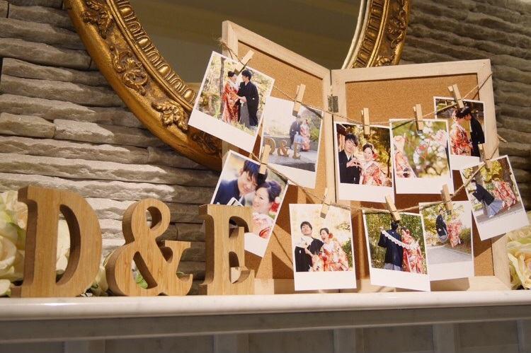 ウェルカムスペースは結婚式の和装前撮り写真をポラロイドのようなプリントにしてコルクボードに装飾